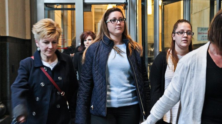 Kathryn Knott, center, leaves court Tuesday. The jury will now decide whether she is guilty in the assault of a gay couple in Center City in 2014. (Kimberly Paynter/NewsWorks)