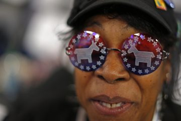 Vivian Stowall of Denver shows off her DNC themed glasses at the 2012 Democratic National Convention in Charlotte