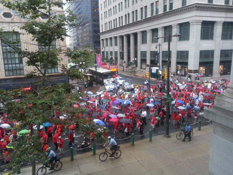 Hundreds of protesters, many of them teachers,  march through Philadelphia to demand more school funding. (Tom MacDonald/WHYY)