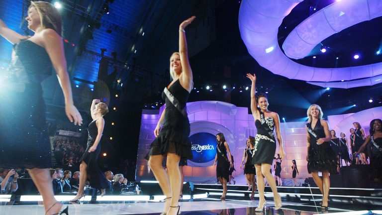 Miss America contestants walk the runway at the beginning of the 2004 competition in Atlantic City, N.J. (AP Photo/Mary Godleski)