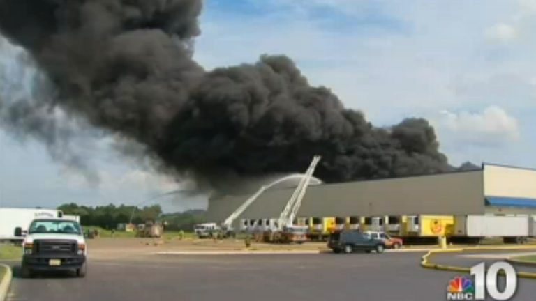 Thick, black smoke pours from the Dietz & Watson warehouse in Delanco, Burlington County. (Image from NBC10)