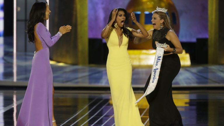 Miss New York Nina Davuluri, center, reacts after being named Miss America 2014 pageant as Miss California Crystal Lee, left, and Miss America 2013 Mallory Hagan celebrate with her. (AP Photo/Mel Evans)