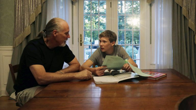 Will Richardson (left) and his son Tucker at their home in Flemington, N.J. Tucker's parents, Wendy and Will, are part of a small but growing number of parents nationwide who are ensuring their children do not participate in standardized testing.  (AP Photo/Mel Evans)