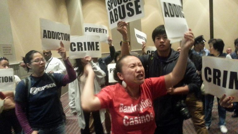 Protestors demonstrate at Tuesday's hearing on casino licensing in Philadelphia. (Tom MacDonald/WHYY)