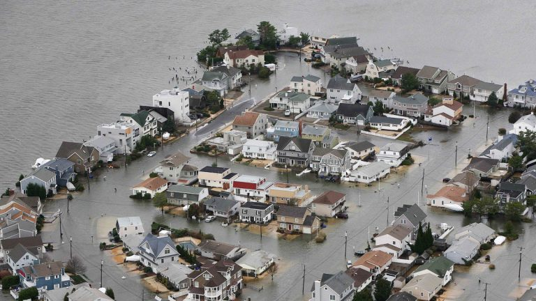 This Tuesday, Oct. 30, 2012 file photo made available by the New Jersey Governor's Office shows flooding on the bay side of Seaside, N.J., after Superstorm Sandy made landfall.