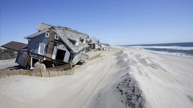 In April 2013, homes severely damaged by Superstorm Sandy line the beach in Mantoloking, N.J.  (AP Photo/Mel Evans, File)