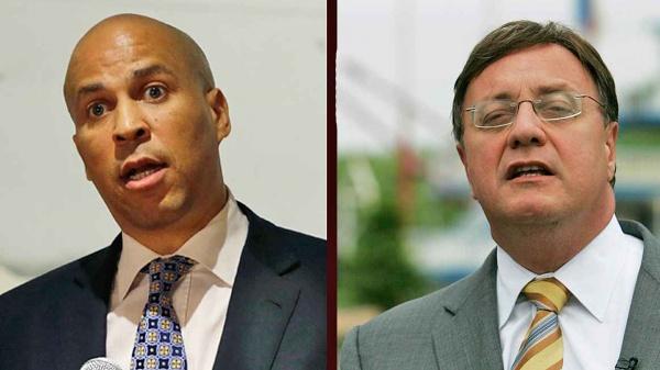 Cory Booker and Steve Lonegan debate Friday in Trenton. (Photos from AP)