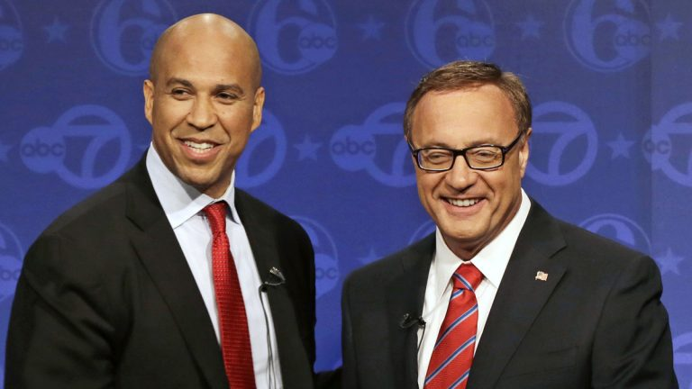 The final U.S. Senate debate between Cory Booker (left) and Steve Lonegan is tonight at Rowan University. (AP Photo/Mel Evans)