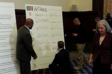 Mayor Nutter watches as executives sign pledge
