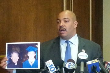 DA Seth Williams holds up victims picture