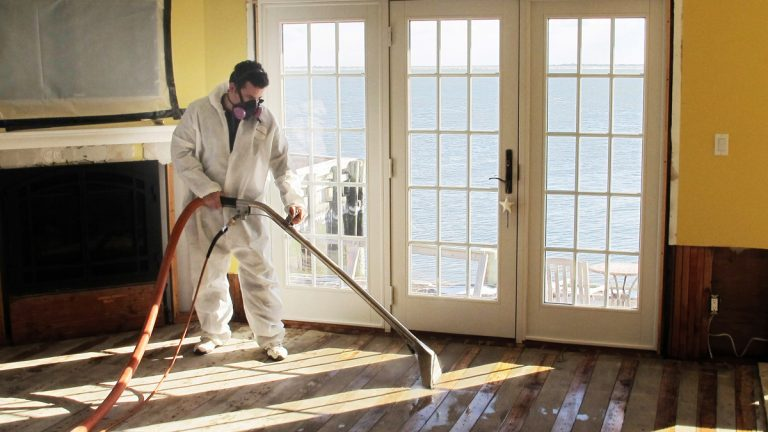 Victor Pena of Flag Enterprises steam-cleans a floor to remove mold.  (AP Photo/Frank Eltman, File)