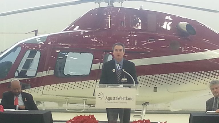 William Hunt of AgustaWestland stands in front of a $3.5 million helicopter his company built in Philadelphia (Tom MacDonald/for NewsWorks)