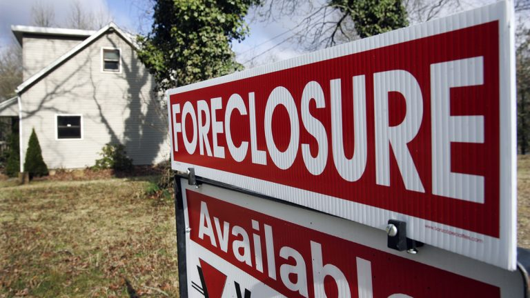A foreclosure sign is seen on the lawn of a home in Egg Harbor Township, N.J (Mel Evans/AP Photo)