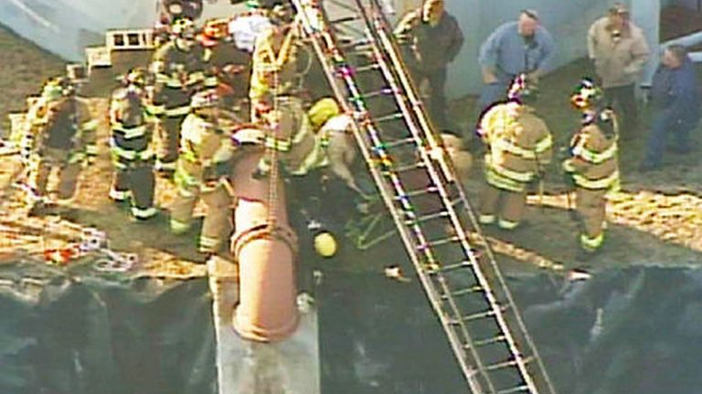 Crews working to get a man out of this water pipe. (Image via NBC New York)
