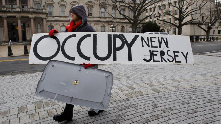 Dusty Hinz, of Philadelphia, outside the Statehouse in Trenton, N.J. Saturday. (AP Photo/Mel Evans)