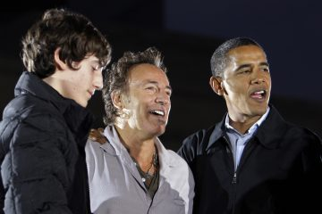 Bruce Springsteen, center, stands with then presidential candidate Barack Obama and his son Sam Springsteen at a rally in Cleveland  Nov. 2, 2008. (AP Photo/Alex Brandon)