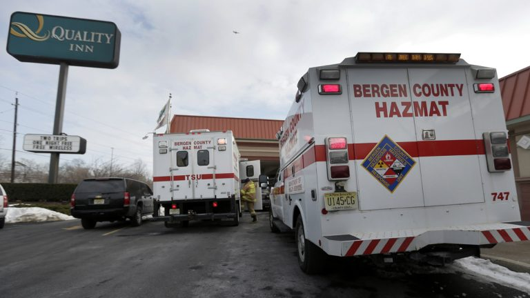 Emergency vehicles are parked outside a Quality Inn in Lyndhurst, N.J. (AP Photo/Charlie Riedel)
