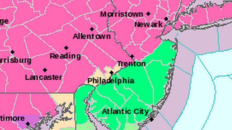 Pink areas are under a Winter Storm Warning. Green areas are under a Flood Advisory. (Image via National Weather Service)