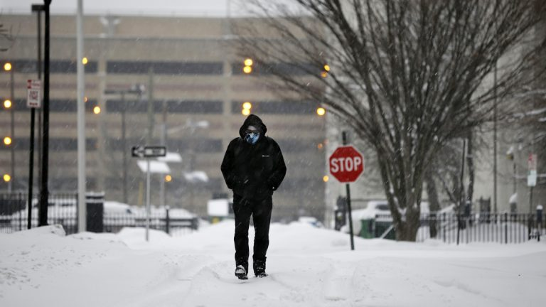 Bob Kay is bundled against the cold and snow as he walks in Trenton, N.J., Thursday, Feb. 13, 2014. (AP Photo/Mel Evans)