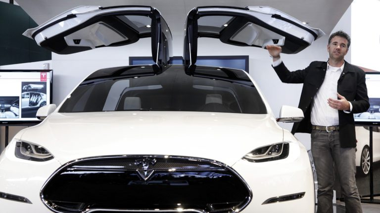 The Tesla Model X at  the 2013 North American International Auto Show in Detroit,  (AP Photo/Paul Sancya)