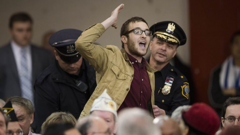 Rowan U student Michael Brein shouts at Gov. Christie, not pictured, as he is removed from a town hall meeting. (AP Photo/Matt Rourke)