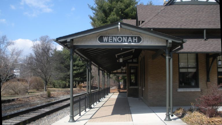 If new passenger train service comes to Wenonah, a new station would be built next to this older one. (Bob Holt/for NewsWorks)