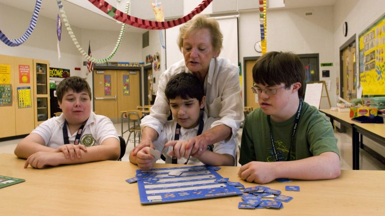 Special education teacher Karen Hansen works with students at the Long Branch Middle School in Long Branch, N.J., Friday, June 1, 2007.   (AP File Photo/Colin Archer)