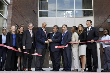 Mayor Cory Booker, center left and Gov. Christie, center right, help celebrate the opening of a new charter school in Newark, N.J. on Sept. 25, 2013. Booker is now in the U.S. Senate.(AP Photo/Mel Evans)