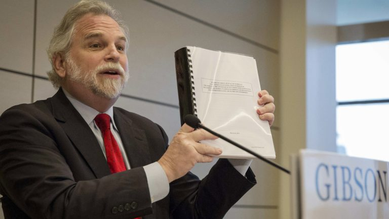 Randy Mastro holds up a copy of his report during a news conference Thursday, March 27, 2014. (AP Photo/Brendan McDermid, Pool)