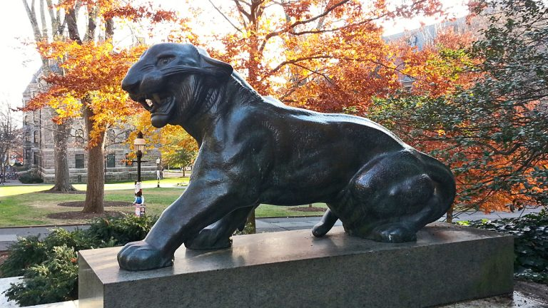 One of two matching tiger statues behind Nassau Hall. (Alan Tu/WHYY)