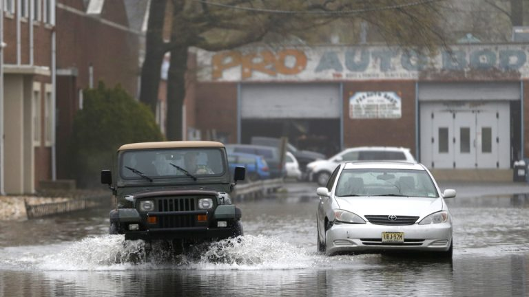Flooded street in Bogota, N.J. on Thursday, May 1, 2014, (AP Photo/Julio Cortez)