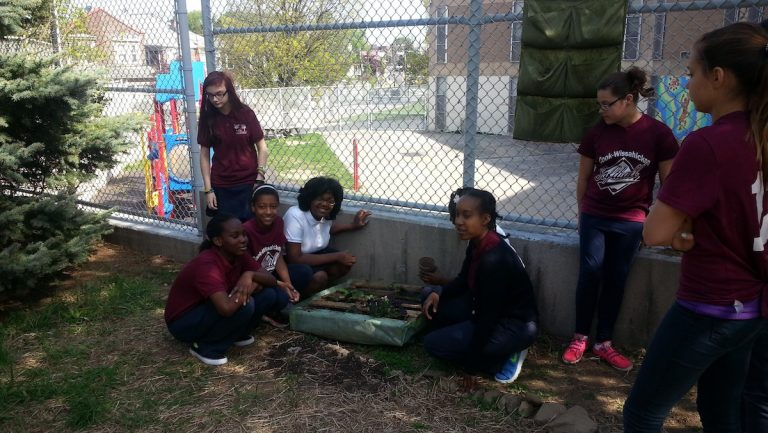 Cook-Wissahickon students displaying a part of their greening efforts. (Queen Muse/for NewsWorks)