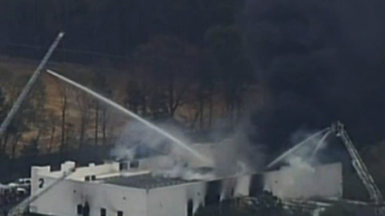 Smoke rising from ResinTech earlier today.  (Image via NBC10)