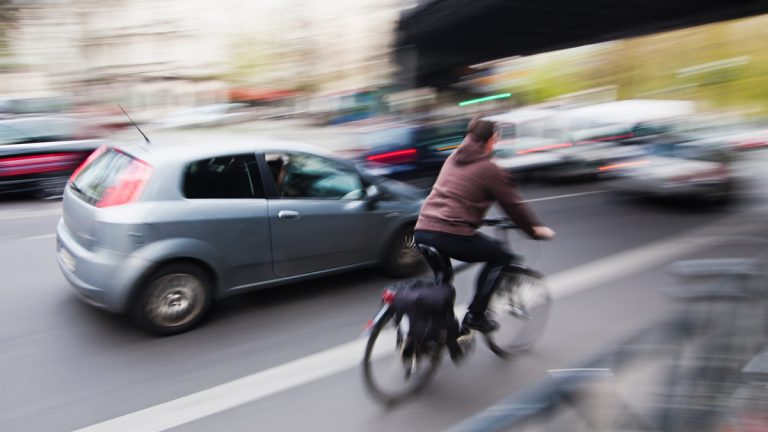 A bill in the New Jersey legislature would require cars to keep their distance from bikers. (Shutterstock)