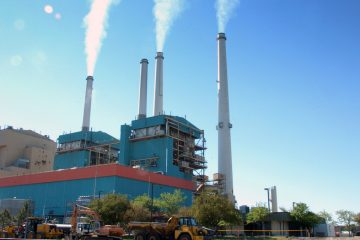 The Obama administration set a goal to cut carbon emissions by power plants by 30 percent by 2030. (AP Photo/Matthew Brown, File)