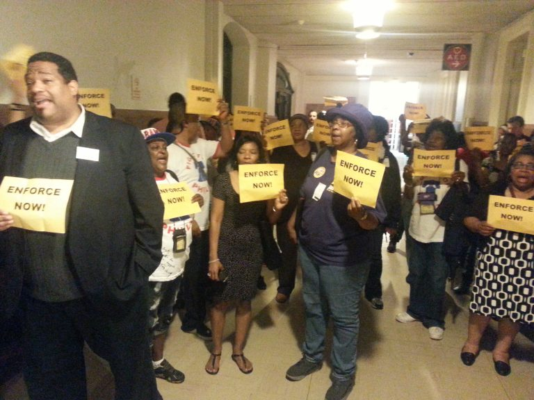 Workers protest outside Mayor's office