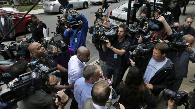 Kevin Roper, center, is surrounded by media  as he leaves a court appearance Weds, June 11, 2014, in New Brunswick, N.J.  (AP Photo/Mel Evans)
