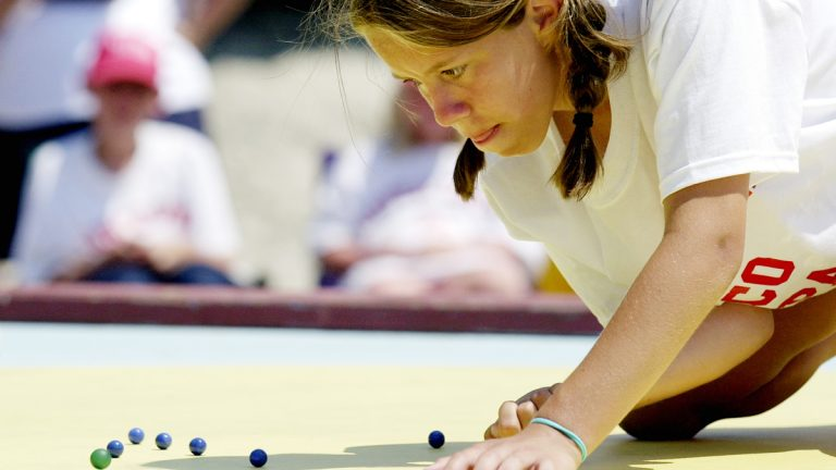 Carly Miller, 12, shoots during the finals of the  National Marbles Tournament in Wildwood in 2004. (AP File Photo/Mary Godleski)