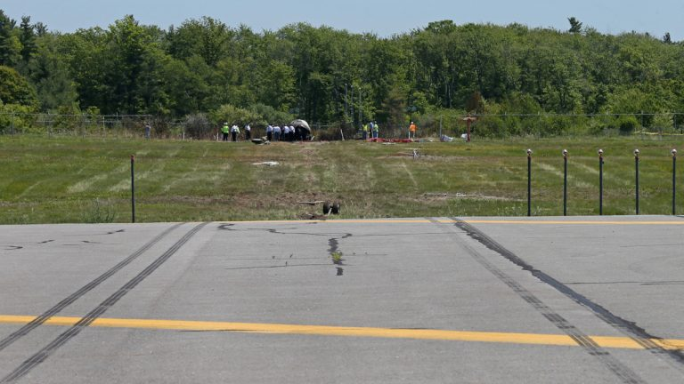 Skid marks at the end of the runway at Hanscom Field. (AP Photo/Boston Herald, Mark Garfinkel, Pool)