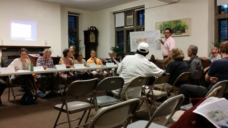 Zoning attorney Bill Curr presents revised building plans to West Mt. Airy Neighbors members and residents at Wednesday's meeting. (Queen Muse/for NewsWorks)