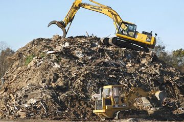 Heavy equipment operators work on a mountain of debris left by Superstorm Sandy. (Mel Evans/AP File Photo)