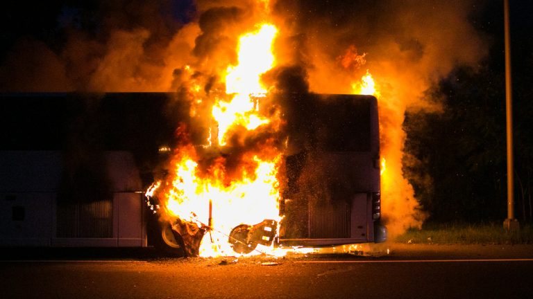 Initial reports say passengers were seen running along the southbound lanes of Interstate 287, away from the blaze. (AP Photo/Jimmy Kastner)