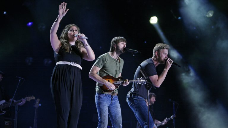 Lady Antebellum members Hillary Scott, left, Charles Kelley, center. and Dave Haywood perform during the CMA Fest in june 2014. (Photo by Wade Payne/Invision/AP)