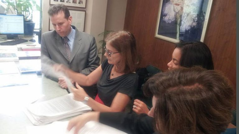 From left, Essex County Freeholder Brendan Gill, Marcia Marley of BlueWave NJ, Analilia Mejia of New Jersey Working Families and Dena Mottola Jaborska of New Jersey Citizen Action review petitions to be submitted in Montclair, where a paid sick leave will be on the November ballot.