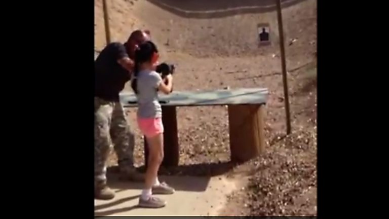 Image from a video released showing the girl firing her first few shots.