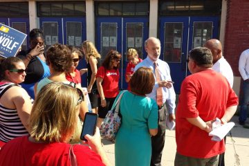 Democratic gubernatorial candidate Tom Wolf is greeted by teachers at the Solis-Cohen Elementary School in Philadelphia Wednesday. (Kevin McCorry/WHYY)
