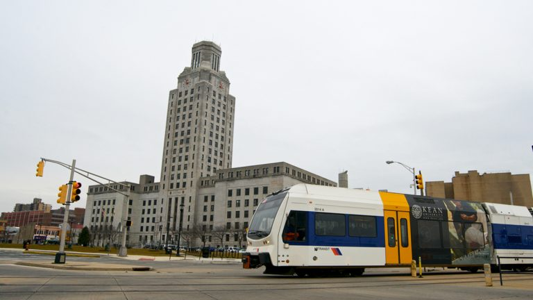 An NJ Transit Riverline train passes in front of City Hall in Camden, N.J. (Bas Slabbers/for NewsWorks)