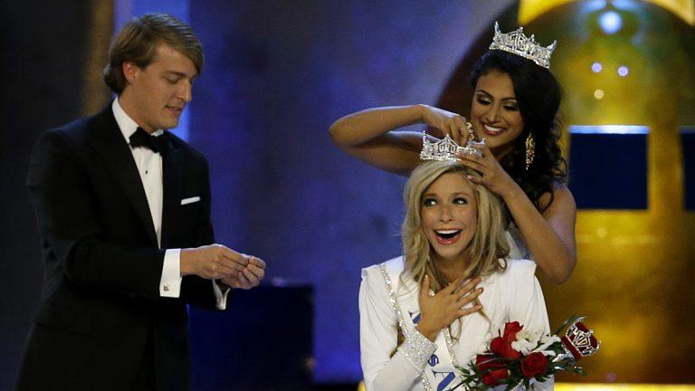 Miss America 2014 Nina Davuluri, top right, crowns Miss New York Kira Kazantsev as Miss America 2015. (AP Photo/Mel Evans)