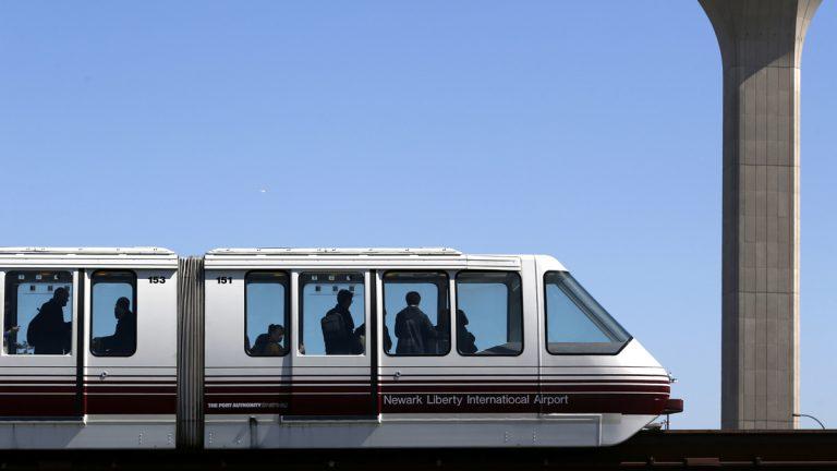 Travelers ride on the AirTrain at Newark Liberty International Airport.  (AP Photo/Julio Cortez)