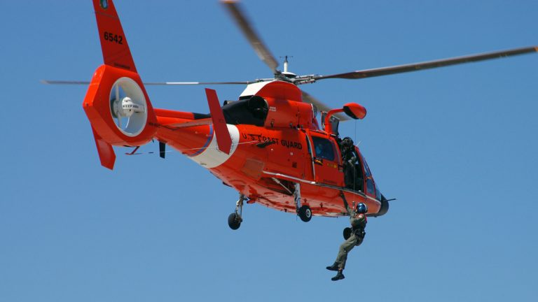 The boaters were rescued by the Coast Guard using a MH-65 Dolphin helicopter, like the one shown here. (FILE Photo by USCG)